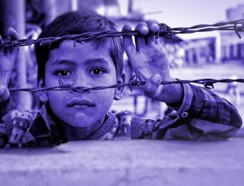 Child and Barbed Wire