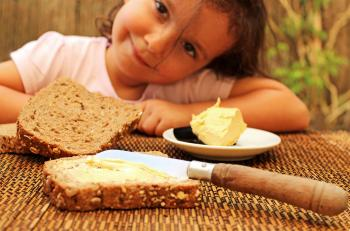 Child preparing to eat bread and butter