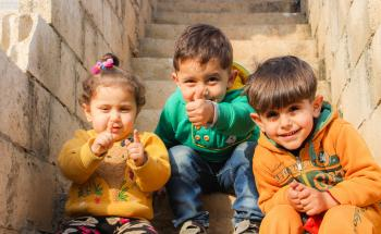 Children Sitting On The Stairs Doing Pose