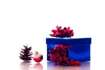 Christmas ornaments and gift box on white