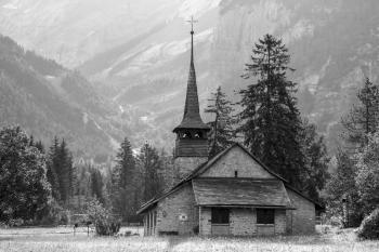 Church in the Open Field Near the Mountain