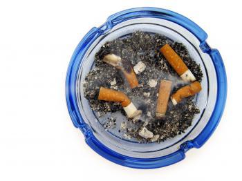 cigarettes in blue ashtray