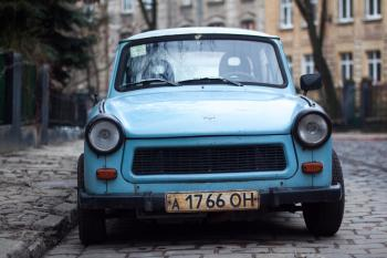 Classic Blue Car Parked Near Fence and Trees