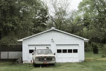 Classic White Chevrolet Pickup Truck Near White 2-door Garage Near Trees