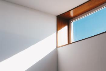 Clear Glass Window With Brown and White Wooden Frame