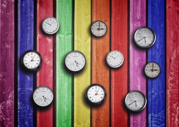 Clocks on colorful wood background - Time concept