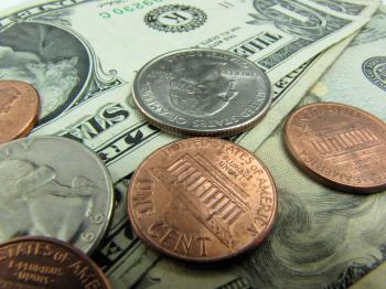 Close-up of US dollars and coins