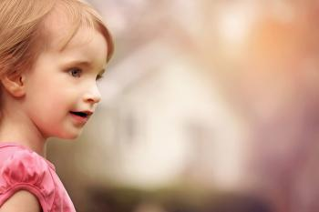 Close Up Photo of Girl in Pink Shirt