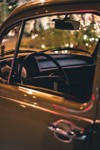 Close Up Photo of Vehicle Steering Wheel and Door