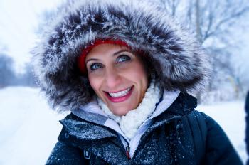 Close Up Photo of Woman Wearing Black Zip-up Parka Coat during Snow Season