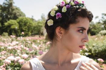 Close Up Photo of Woman With Floral Headband