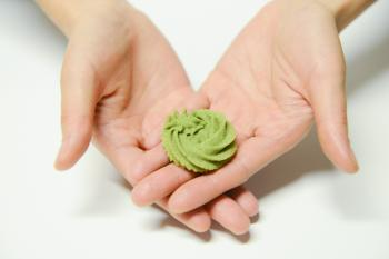 Close-Up Photography of a Person Holding Icing