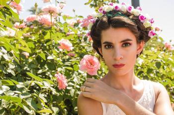 Close-Up Photography of a Woman Wearing Flower Headdress