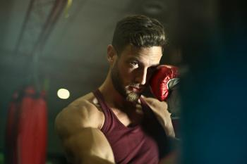 Close-up Photography of Man Wearing Boxing Gloves