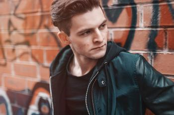 Close-up Photography of Man Wearing Leather Jacket