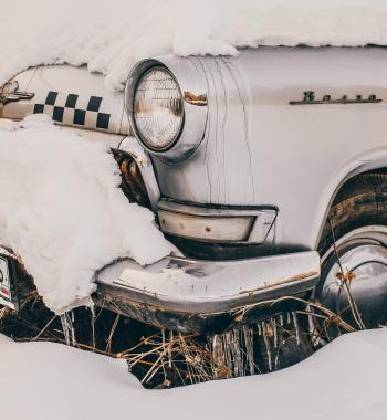 Close-Up Photography of Vintage Car Covered With Snow