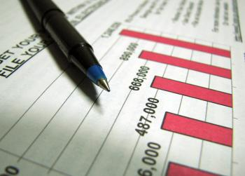 Closeup of a tax income graph and pen