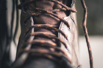 Closeup Photo of Brown Lace-up Boot