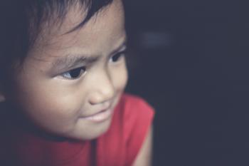 Closeup Photo of Toddler's Wearing Red Tank Top