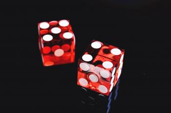 Closeup Photo of Two Red Dices Showing 4 and 5