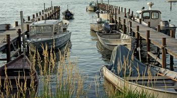 Cluster of Grey Motorboat on Brown Wooden Dock