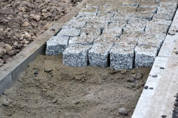 Cobbles in pavement