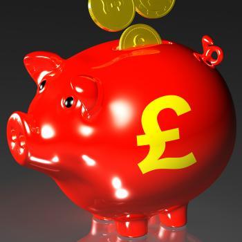 Coins Entering Piggybank Showing British Investing