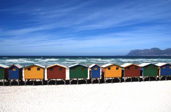 Colorful Cottages Near the Sea Under Blue Sky during Daytime