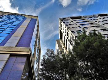Concrete Building Photo Under Cloudy Sky