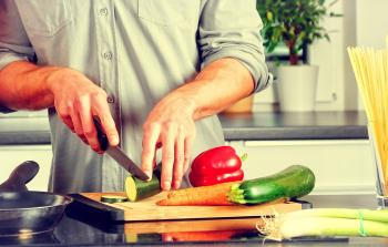 Cooking - A Man Chopping Veggies