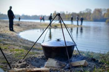 Cooking food in nature against the backdrop of the river