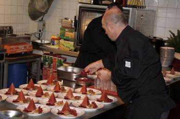 Cooks at work making desert