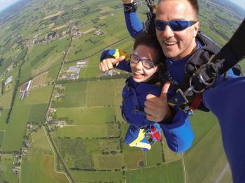 Couple in Blue Suit Paragliding