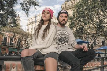 Couple Sitting on Raillings