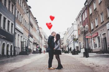 Couple Walking on City Street