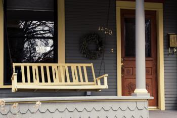 Cozy house veranda with swing