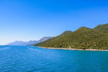 Croatian coastline with blue water and hills