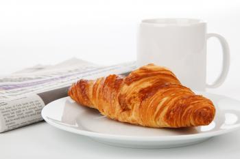 Crossant Bread on White Ceramic Plate