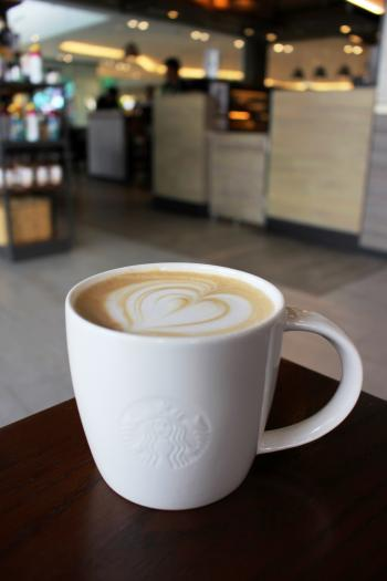 Cup of hot coffee in Starbucks
