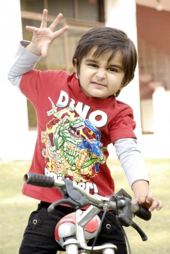 Cute Baby Boy with Bicycle