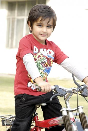 Cute Kid with Bicycle