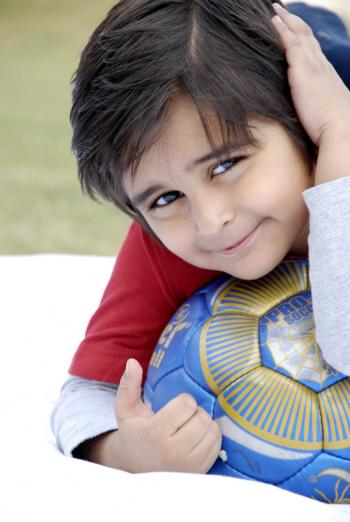 Cute Kid With Football