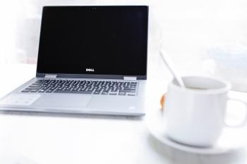 Dell Laptop in Front of Cup of Coffee