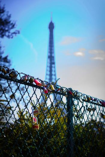 Depth of Field Photography of Love Keys on Chain Link Fence in Front of Eiffel Tower