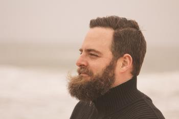 Depth of Field Photography of Man in Black Turtle Neck Top