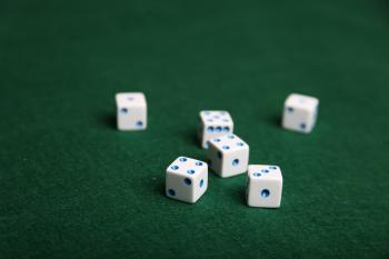 Dice on green felt table