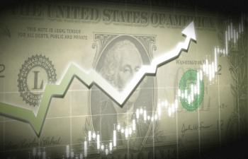 Dollar bill with financial graph superimposed
