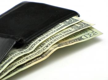 Dollar bills in a black wallet