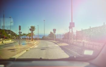 Driving along an ocean road