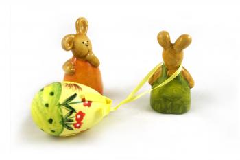 Easter rabbits - one dragging an egg